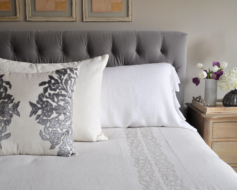 bedroom bed with tufted headboard linen bedding gray and white