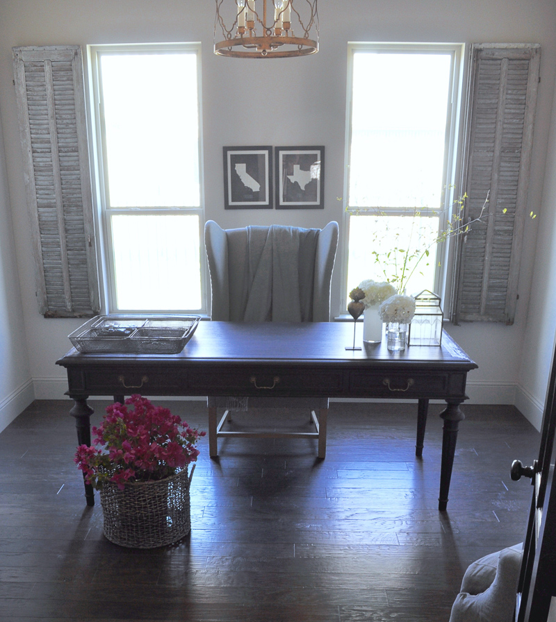 Sophisticated Home Office with Black Desk and Vintage Gray Shutt