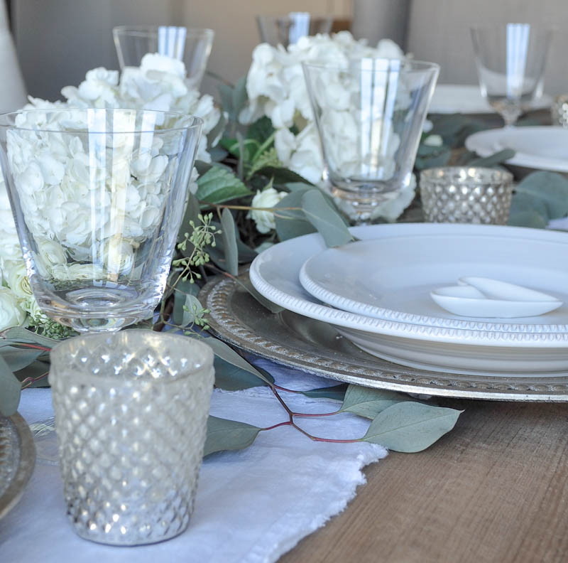 White Table Setting with Silver Chargers and Votive