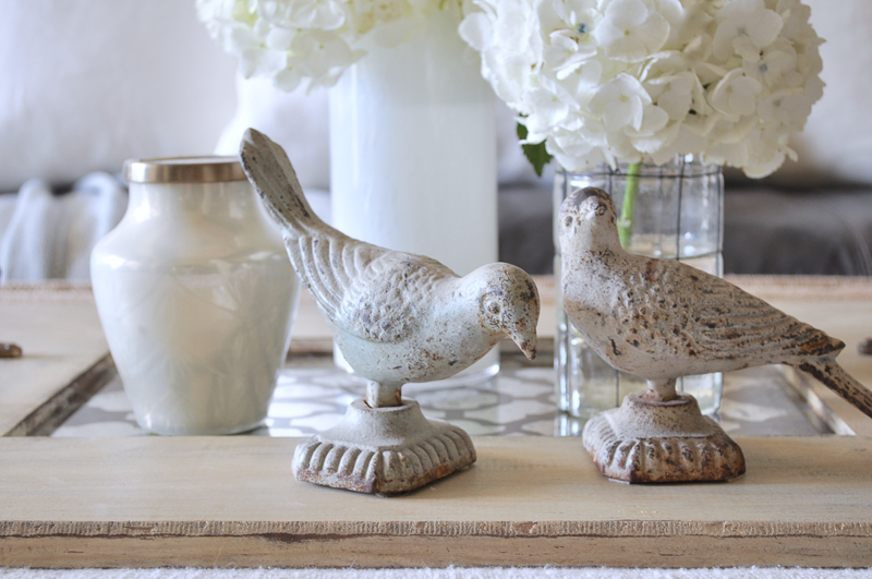 Coffee Table Vignette with Hydangeas Birds Statues and Tray
