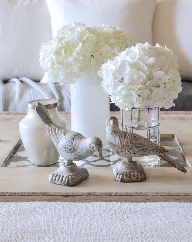 Coffee Table Vignette with Hydangeas Birds and Tray White Linen