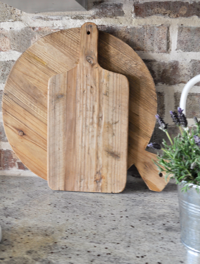 Kitchen Counters with Vintage Cutting Boards and A Brick Backspl