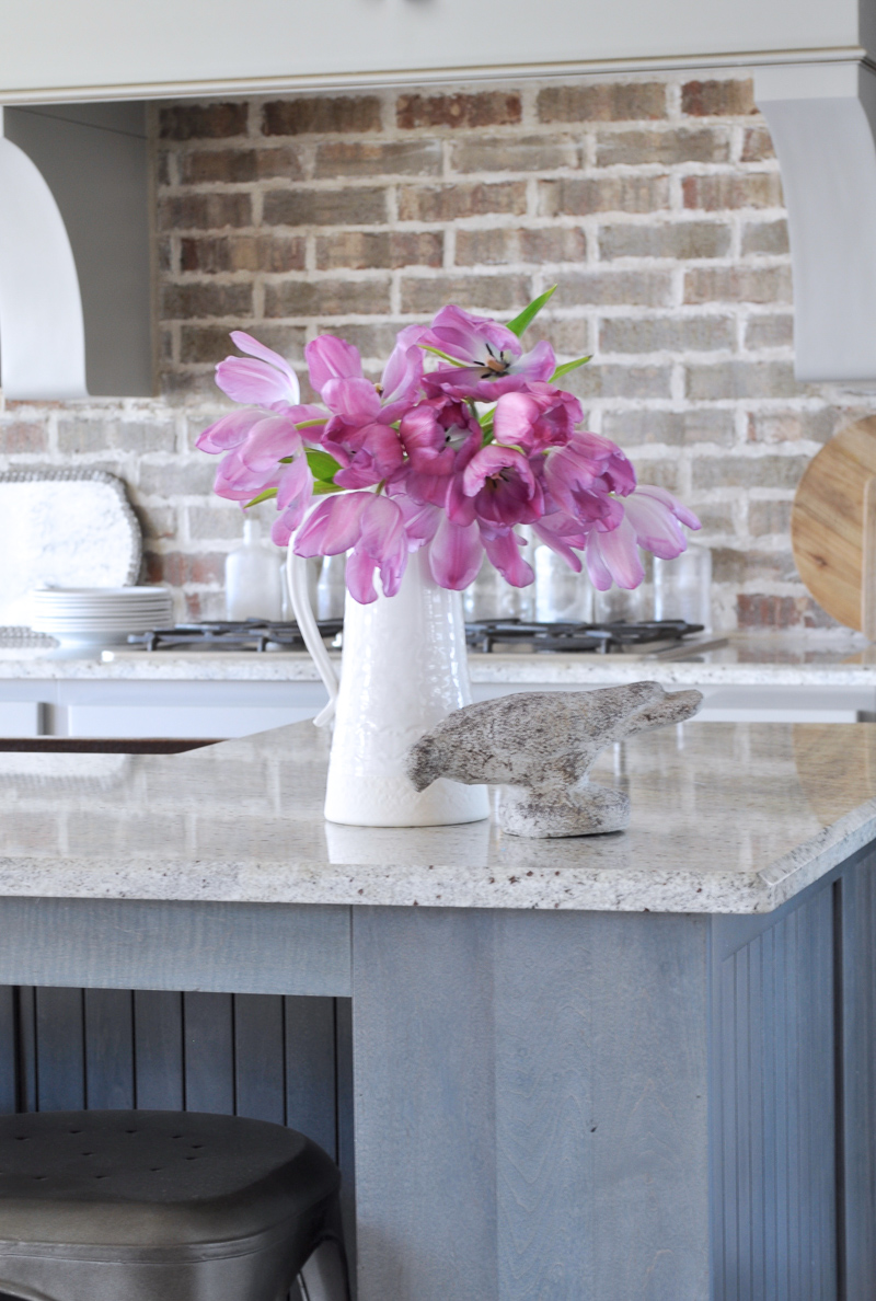 Pink Flowers in a White Pitcher Spring Decor Kitchen with Brick