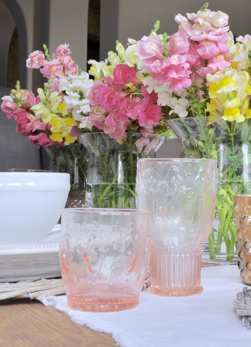 Dining Room Table Setting with Pink Glass