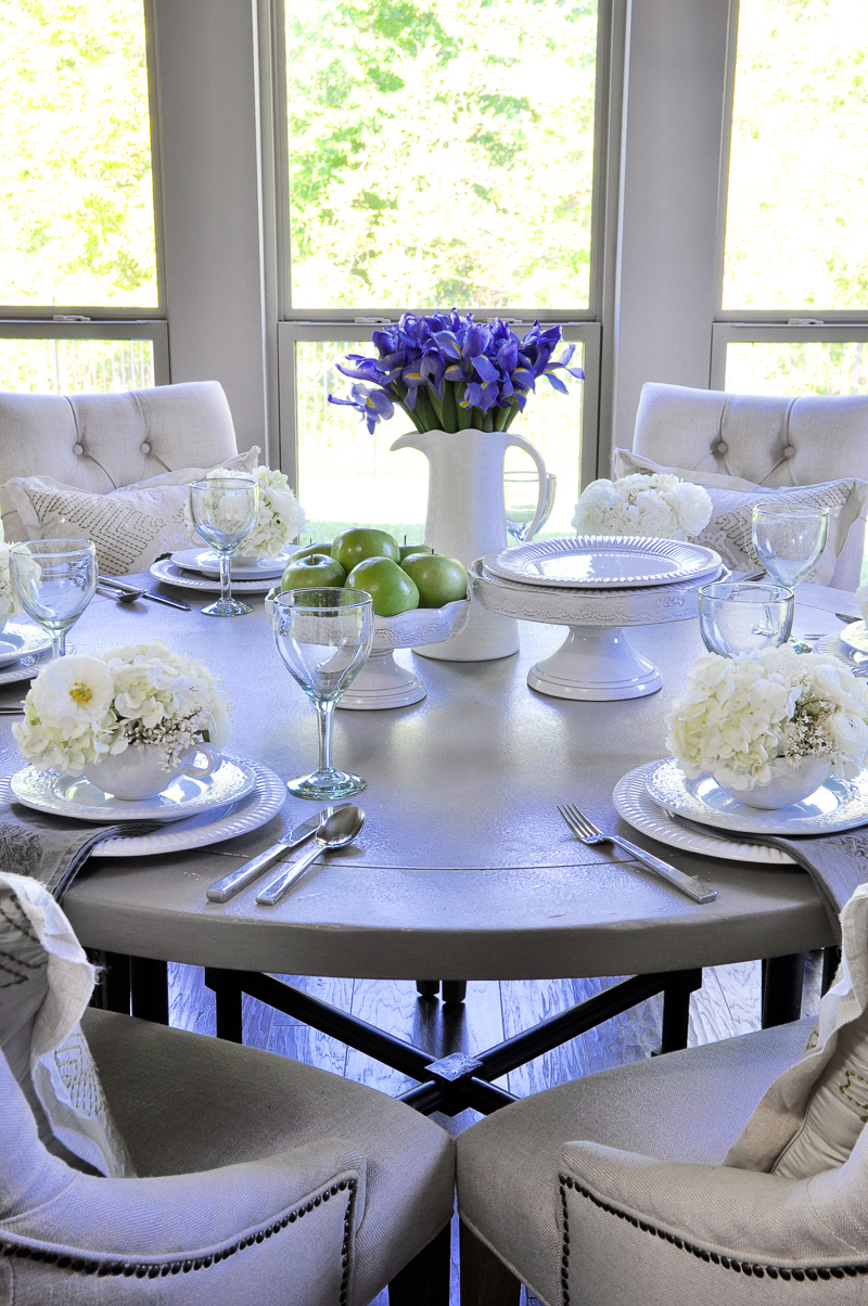 beautiful table setting with spring flowers and white dishes-4