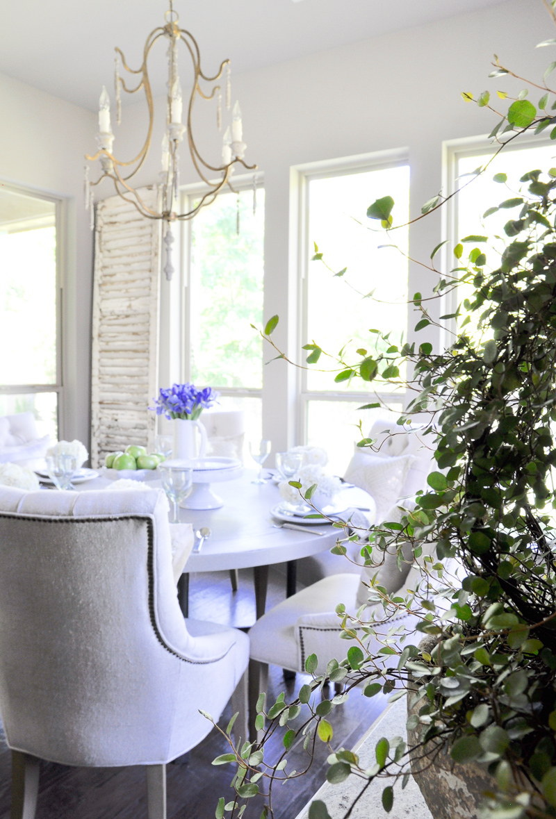 beautiful white dining room with spring flowers_