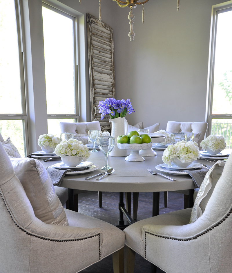 beautiful white tablescape with green apple on cake stands