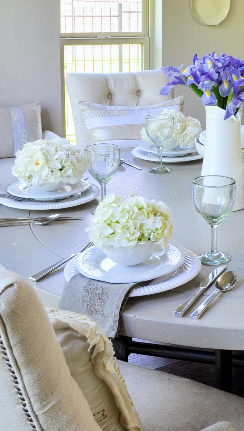 gorgeous white flowers filled tea cups