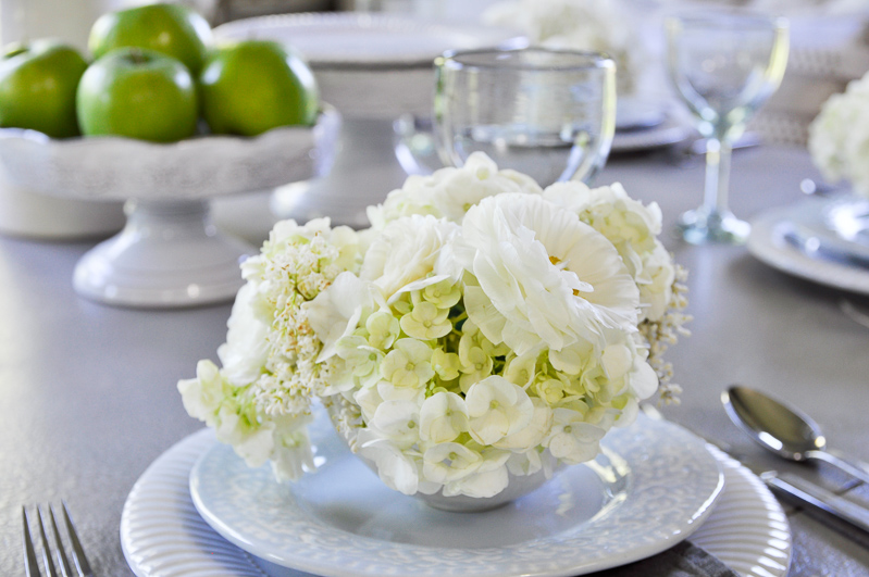 gorgeous white tablescape for spring with white flowers and green apples_