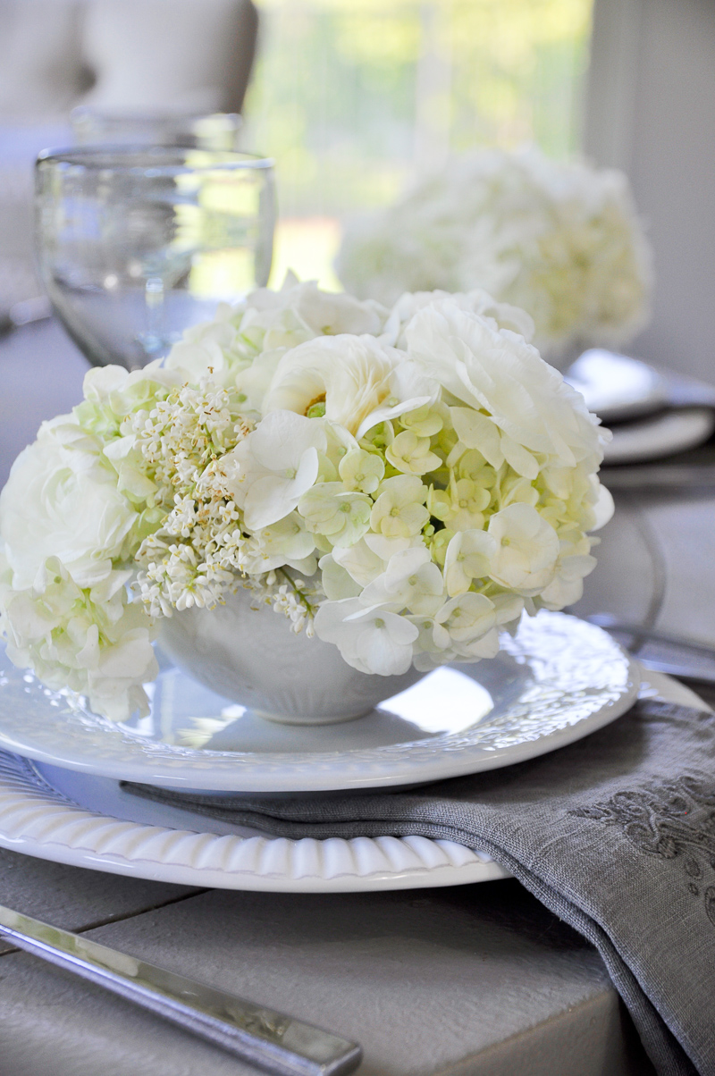 teacups filled with white flowers for shower luncheon wedding