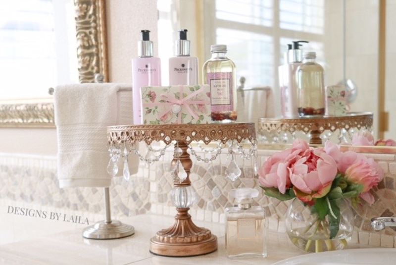 Beautiful Cake Stand in a Bathroom with Necessities by Designs by Laila