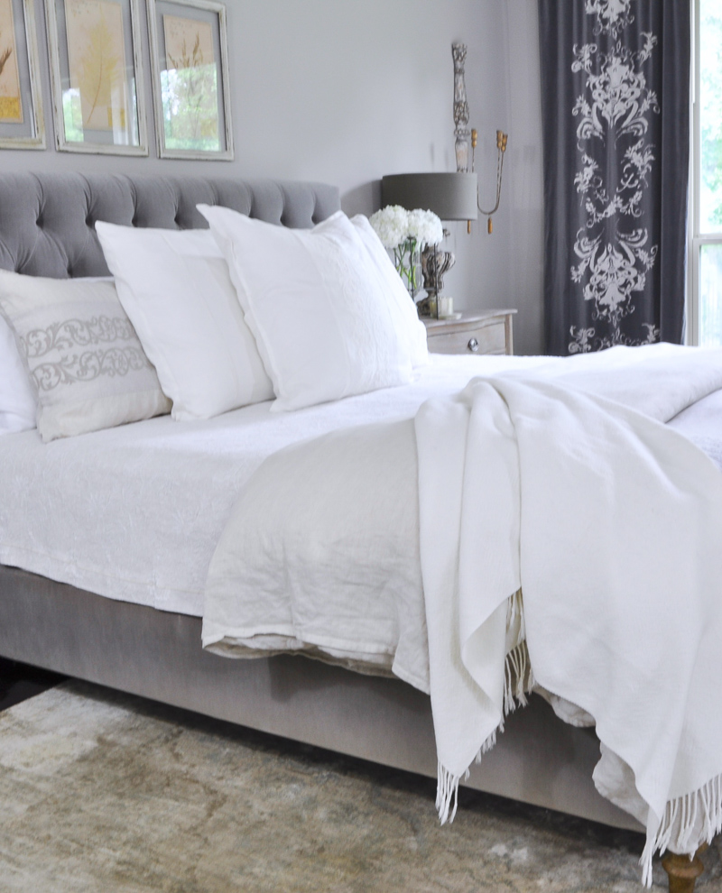Beautiful Gray Bedroom with Linen Bedding and Gray Tufted Bed