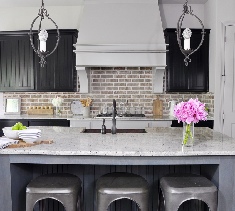 Beautiful Kitchen with Brick Backsplash and Industrial Stools