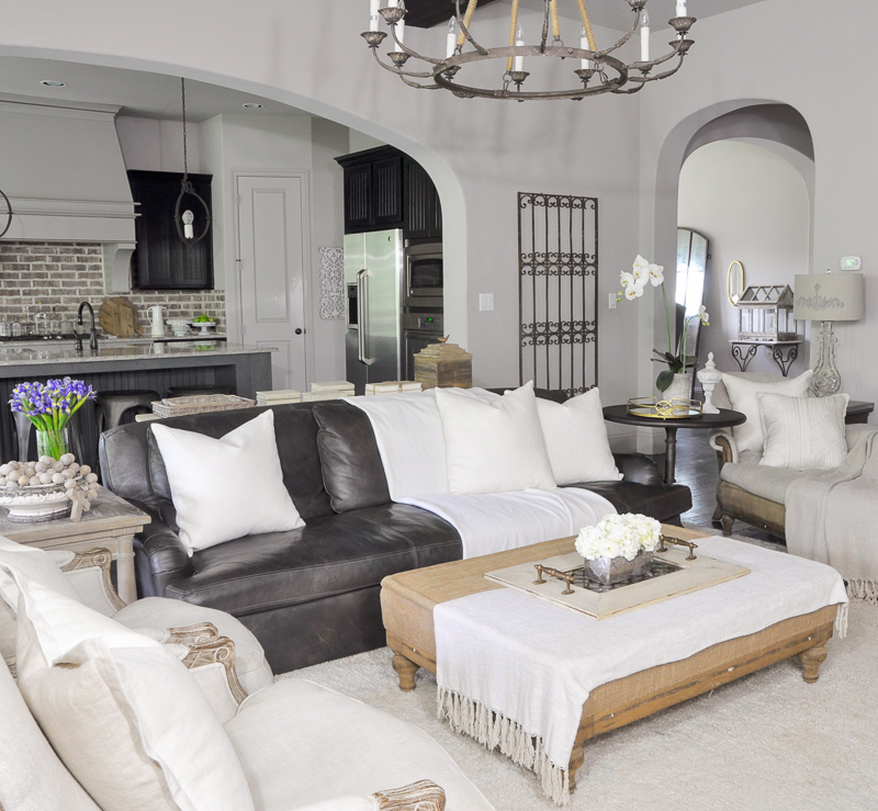 Family Room with Leather Sofa and Linen Chairs