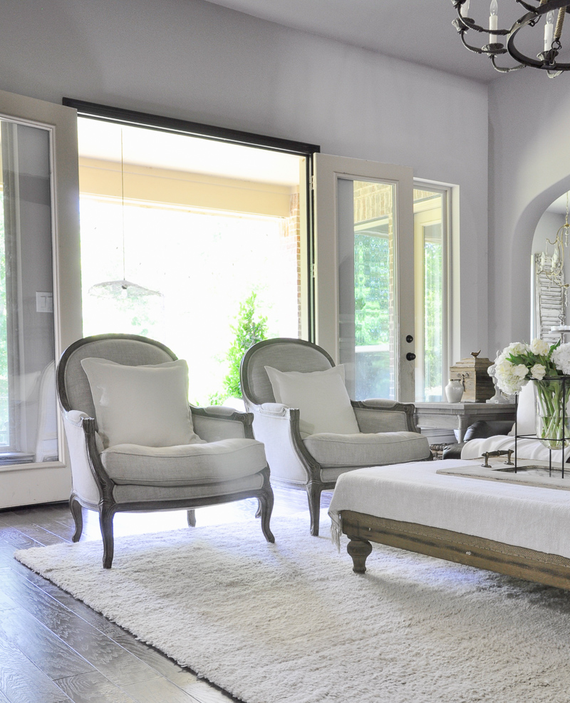 Family Room with Beautiful Linen Arm Chairs by Decor Gold Designs