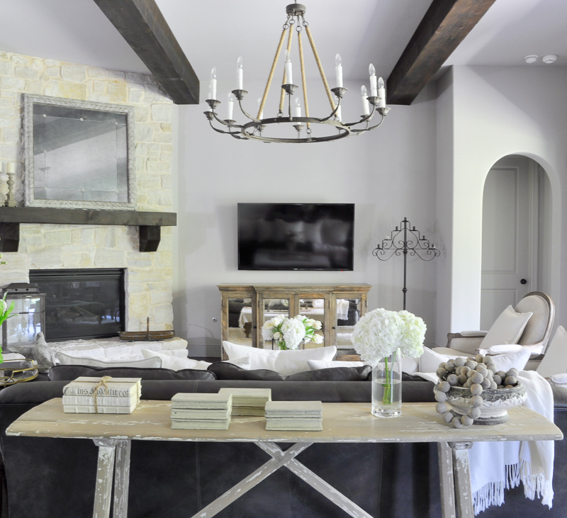 Stunning Family Room with Beams and Rustic Charm by Decor Gold Designs_