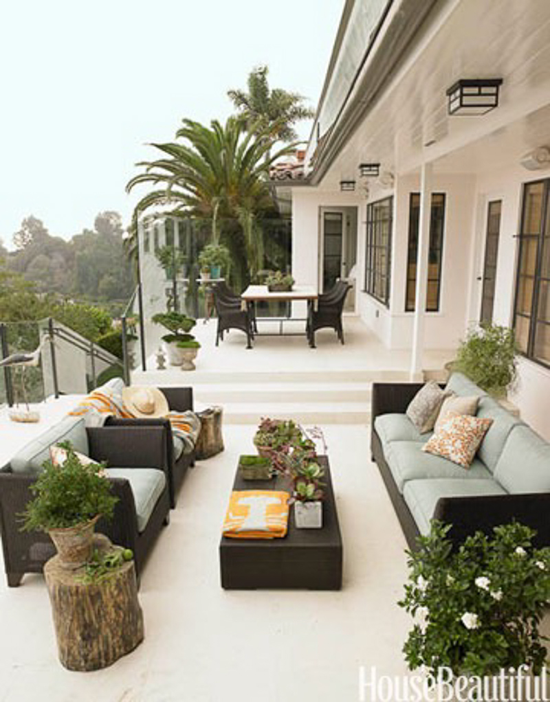 Gorgeous terrace with dark outdoor furniture
