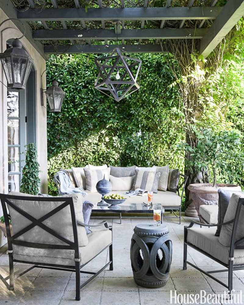 gray and white patio with pergola and restoration hardware outdoor furniture