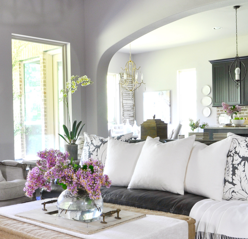 Beautiful White Accents in Family Room Ottoman with Vase Full of Crepe Myrtle Clippings_