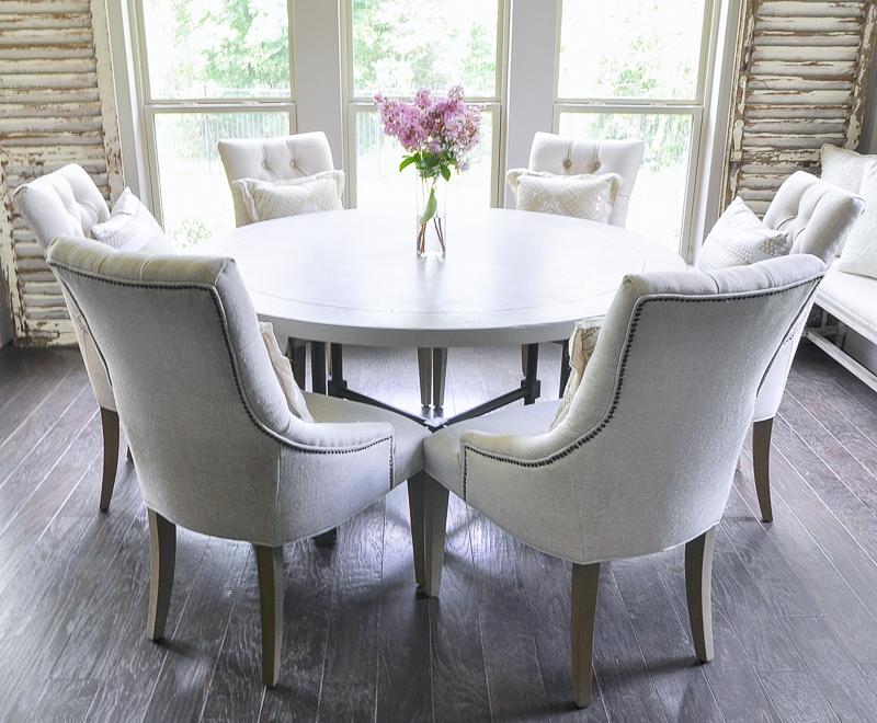 Bright and light breakfast nook with round table and six seats_