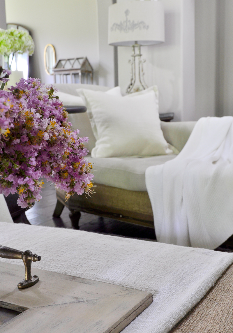 Cozy White Chaise with Linen Pillow and Throw for Summer