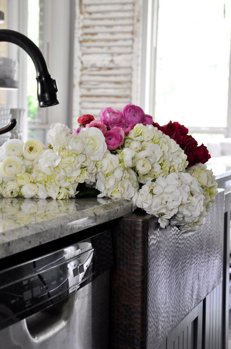 Gorgeous Kitchen Flowers in Copper Sink