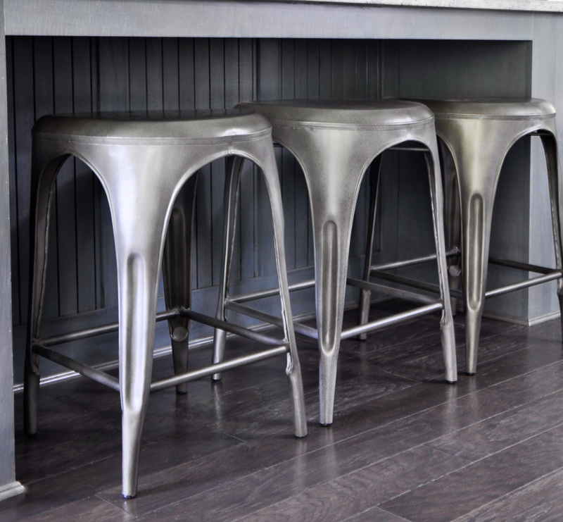 Gunmetal bar stools in kitchen with blue gray cabinets