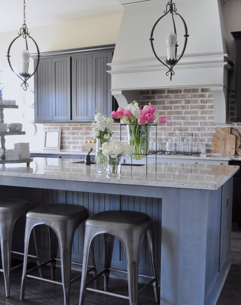 Industrial Kitchen Brick Backsplash and Large Venthood_