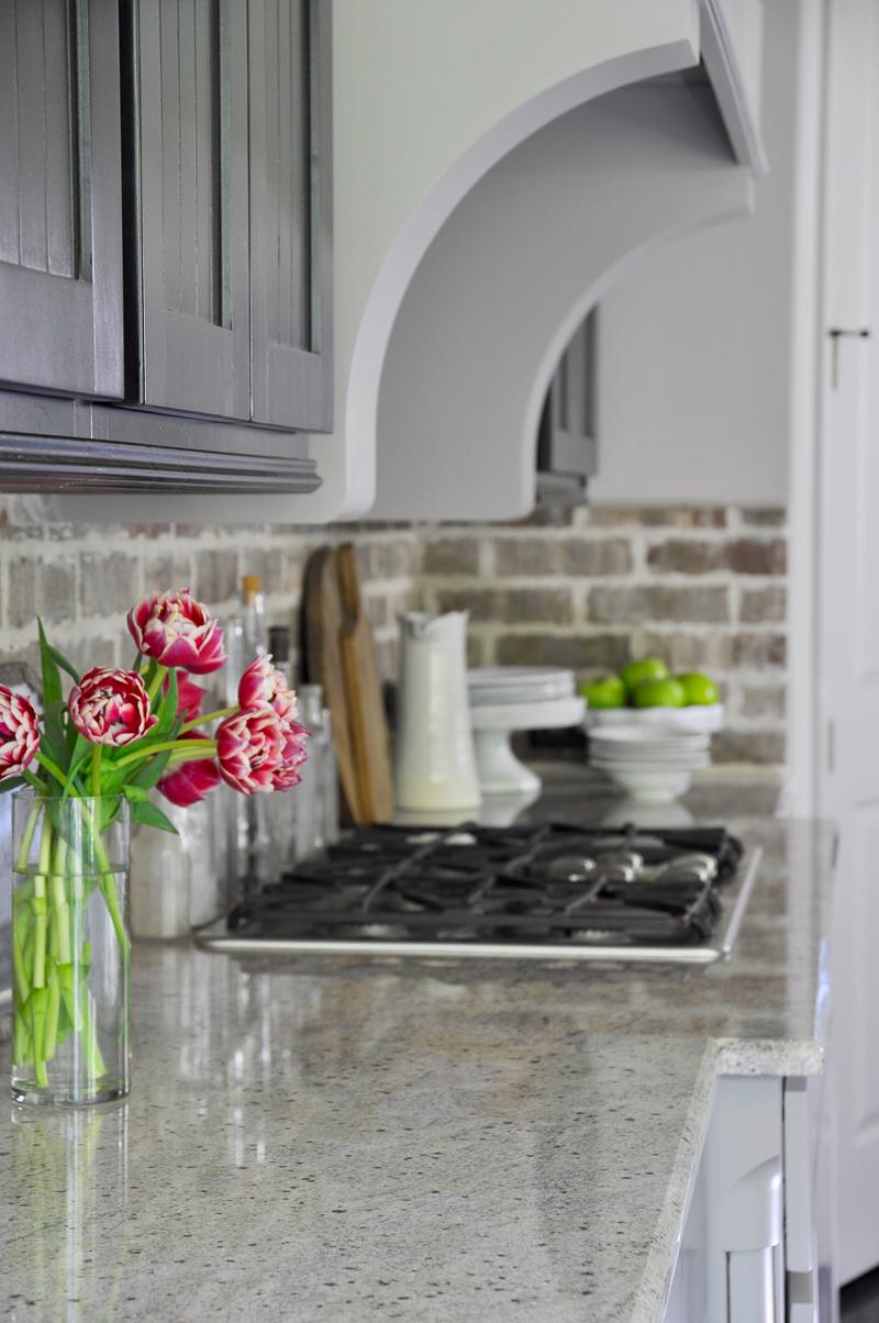 Industrial Kitchen Brick Backsplash and White Pottery Accessories-2