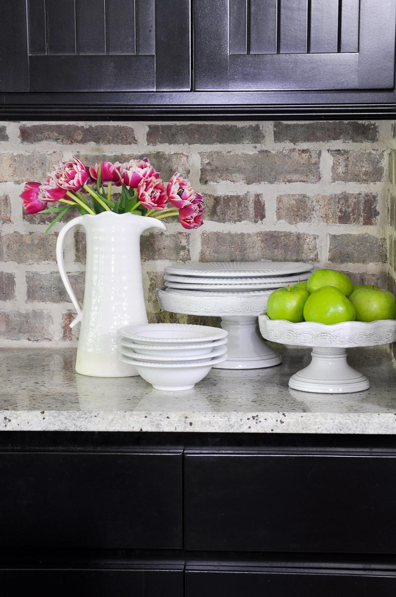 Industrial Kitchen Brick Backsplash and White Pottery Accessories