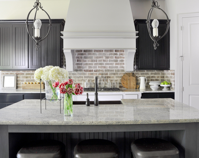 Industrial Kitchen with Brick Backsplash and Statement Venthood_
