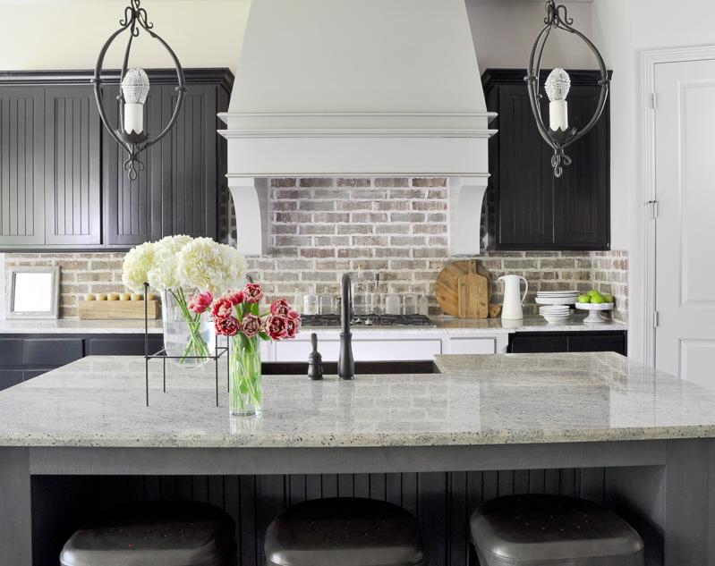 Industrial Kitchen with Brick Backsplash and Statement Venthood_