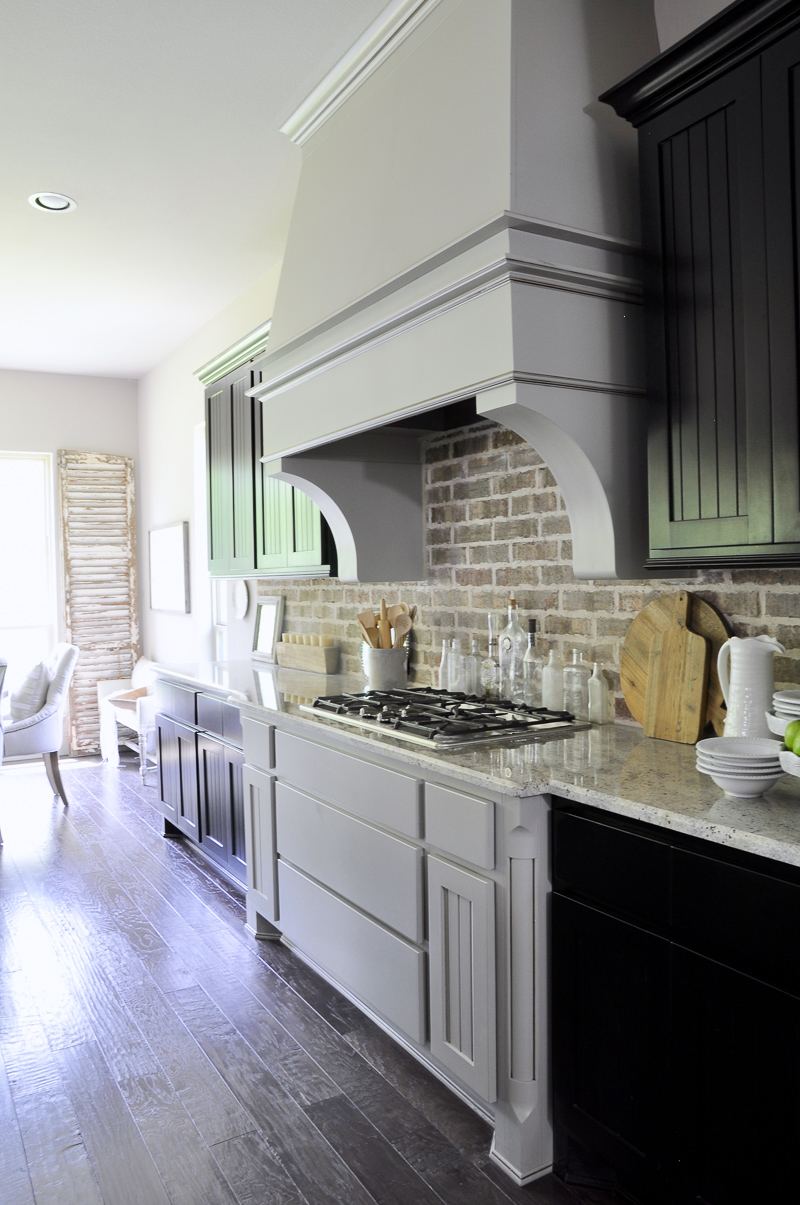 Kitchen with Statement Vent Hood and Black Cabinets-4