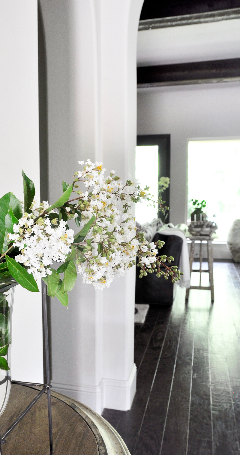 Stunning Foyer with Arches Beams and White Summer Flowers_