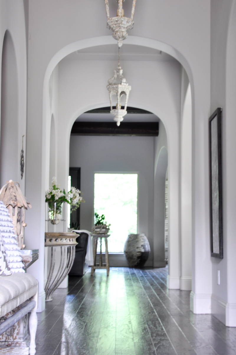 Stunning Summer Entry Hall with Arches Pendant Lights and Beams