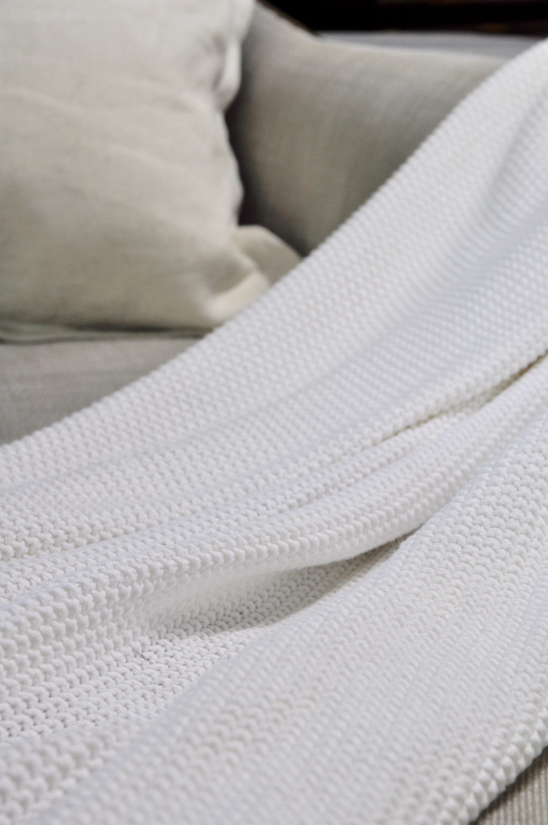 White Summer Throw Blanket on a Linen Chair_