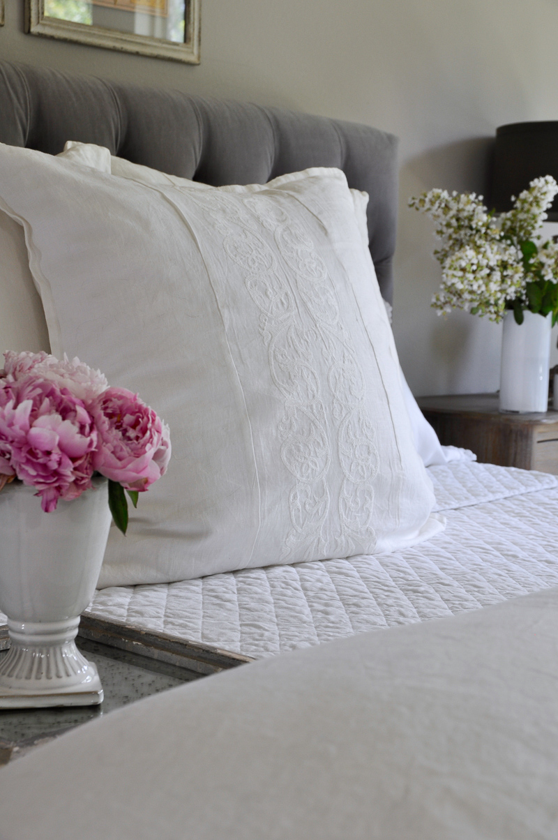 White linen bedding with embroidered sham so gorgeous