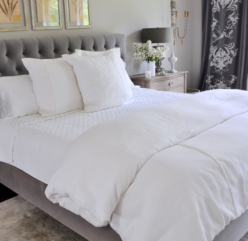 beautiful all white summer bedding in gray and white room