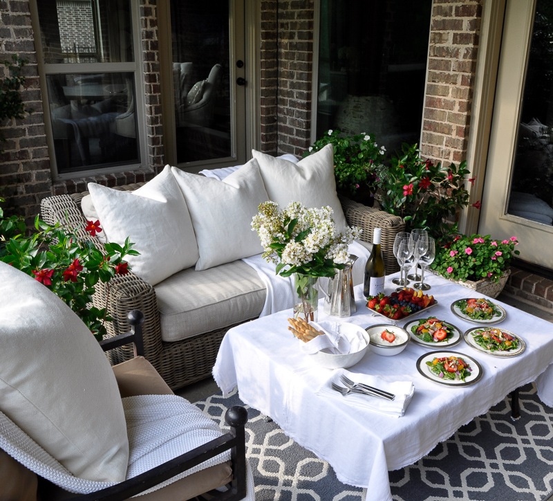 Outdoor Patio Dinner With Flowers White Dinnerware And Pewter And Beautiful  Salads And Fruit 20