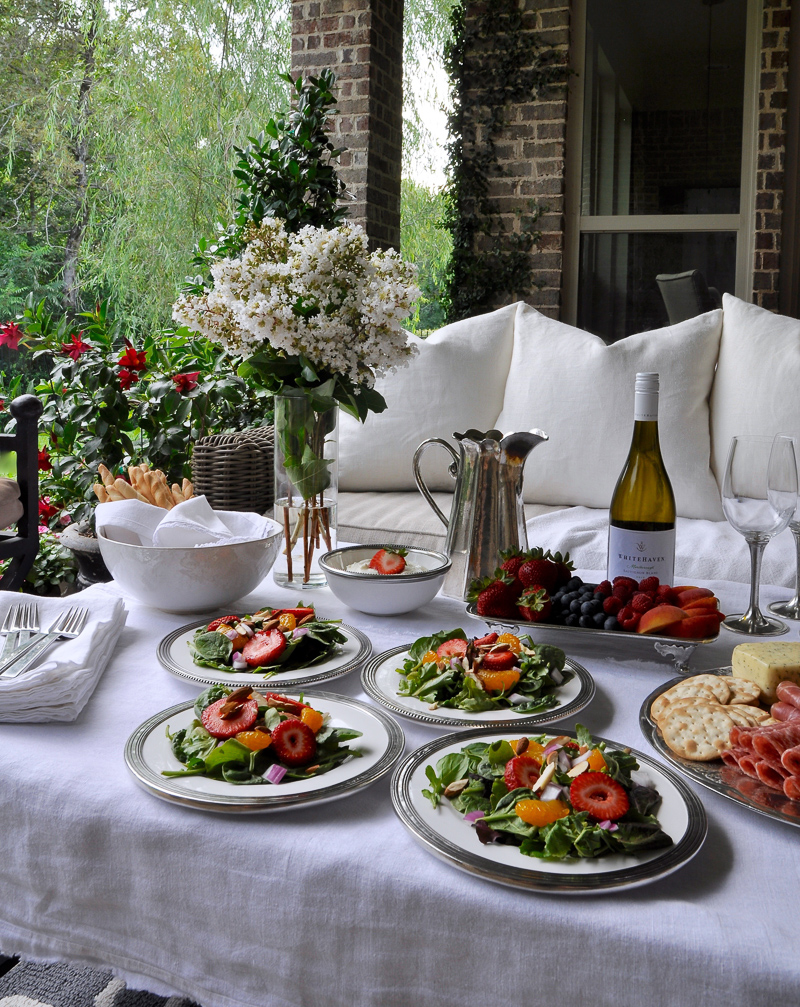 Summer outdoor patio party with flowers white linens and beautiful white and pewter dishes-2