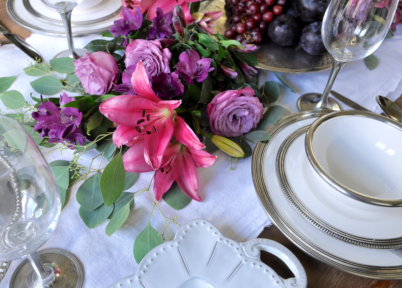 dinner party set with arte italica pieces and beautiful floral garland centerpiece_