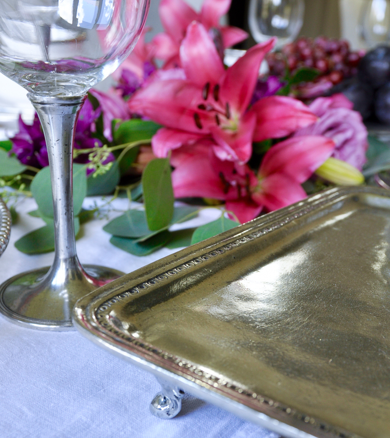 pewter serverware set for a dinner party with beautiful, large floral design