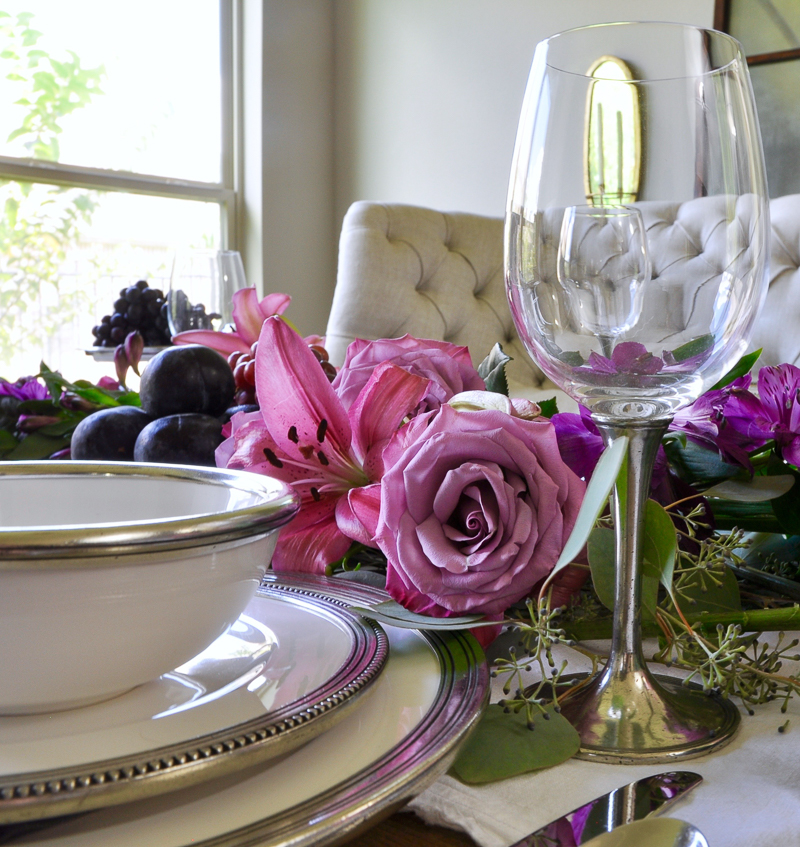 pewtered rimmed dishes and wine glasses add elegance to dining table