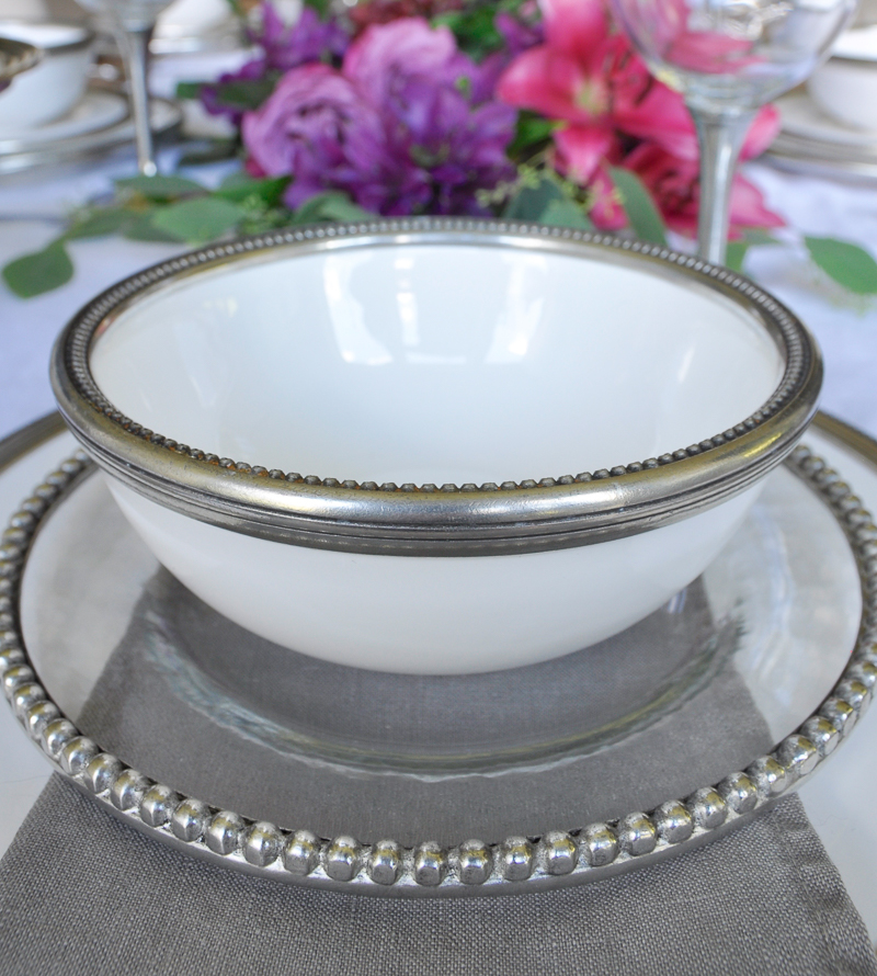 pretty glass and ceramic dishes with pewter rims and matching wine glasses_