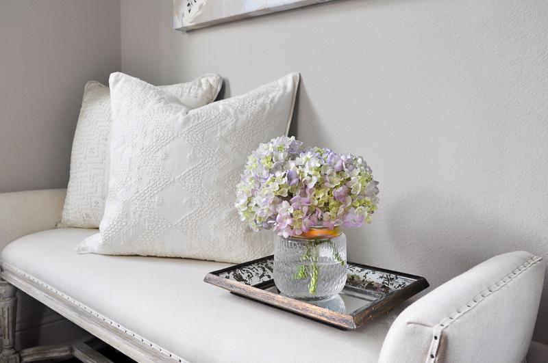 Beautiful white pillow on bench_