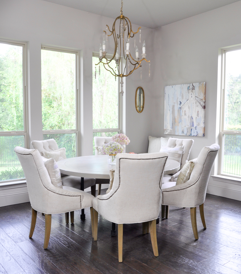 Bright breakfast nook with round six seat