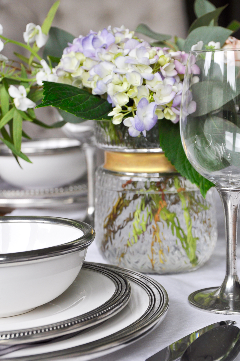 beautiful table pewter rimmed dishes and flowers
