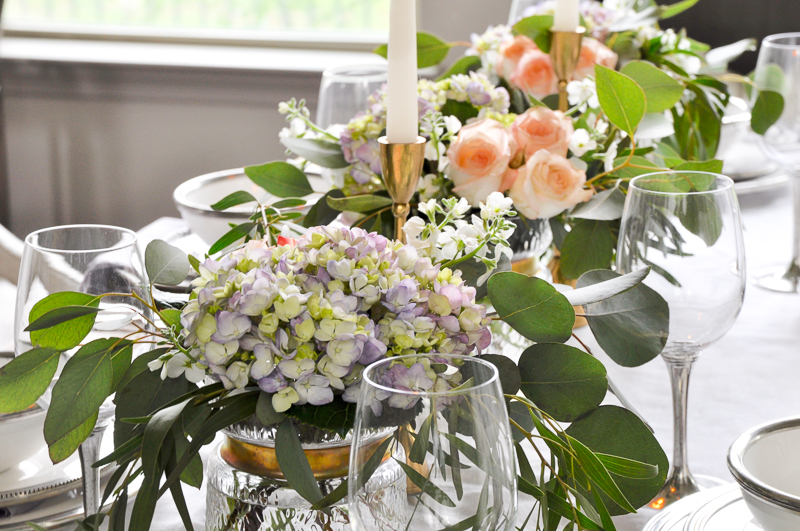 beautiful tablescape row of flowers in gold rimmed vases