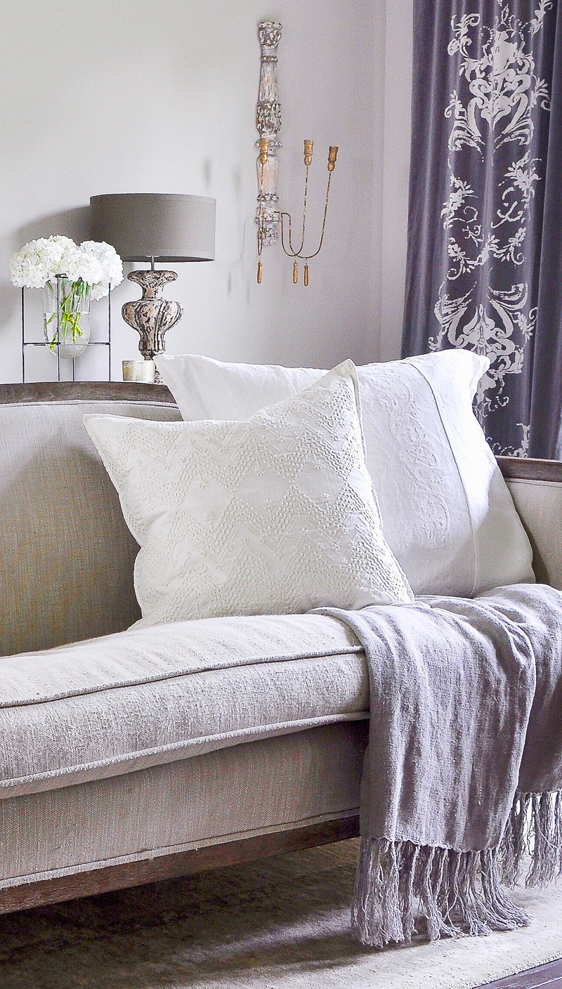 beautiful white pillow in gray and white bedroom_