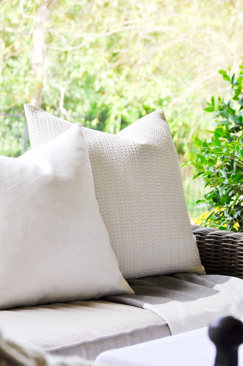 beautiful-outdoor-couch-with-white-pillows_